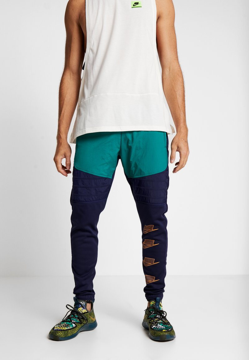 Nike Performance - PANT - Tracksuit bottoms - blackened blue/mystic green/kumquat