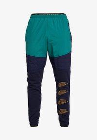 Nike Performance - PANT - Tracksuit bottoms - blackened blue/mystic green/kumquat - 4