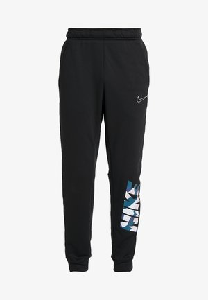 THERMA PANT TAPER - Tracksuit bottoms - black/white