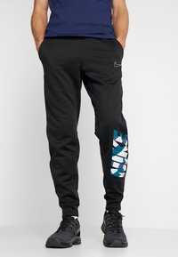 Nike Performance - THERMA PANT TAPER - Trainingsbroek - black/white - 0