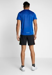 Nike Performance - WILD RUN SHORT - Träningsshorts - black/silver - 2