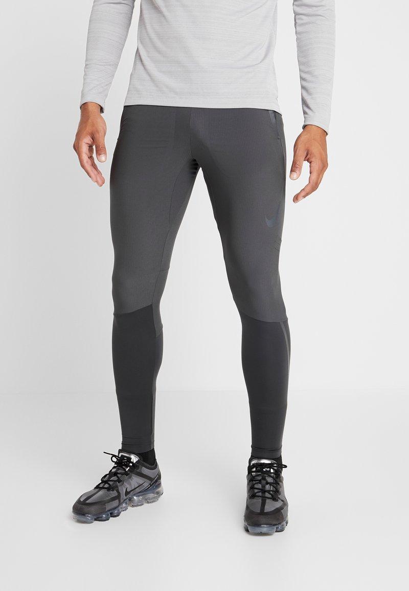Nike Performance - SWIFT PANT - Pantalones deportivos - dark smoke grey/black