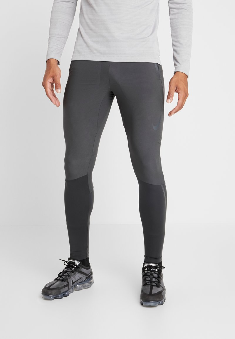 Nike Performance - SWIFT PANT - Pantaloni sportivi - dark smoke grey/black