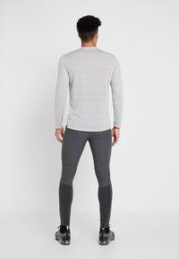 Nike Performance - SWIFT PANT - Tracksuit bottoms - dark smoke grey/black - 2