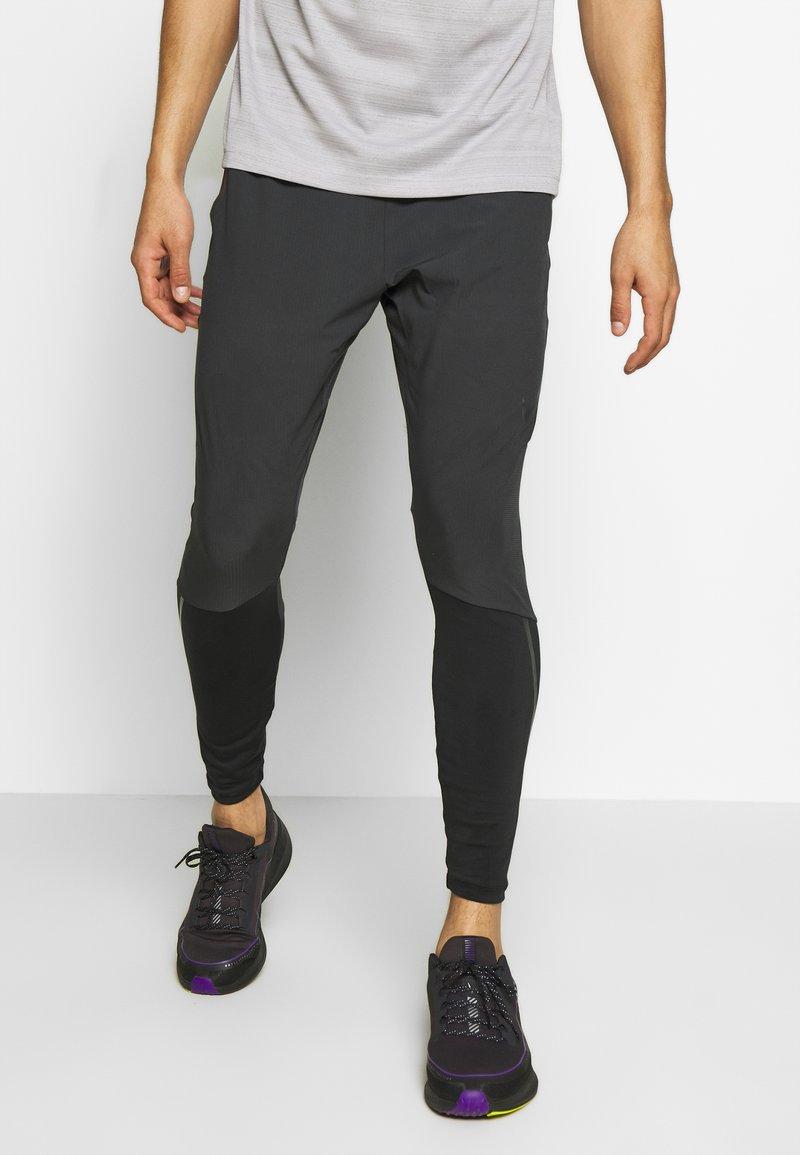 Nike Performance - SWIFT PANT - Verryttelyhousut - black/reflect black