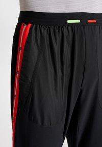 Nike Performance - WILD RUN PANT - Träningsbyxor - black/electric green/habanero red - 6