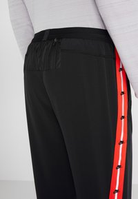 Nike Performance - WILD RUN PANT - Träningsbyxor - black/electric green/habanero red - 5