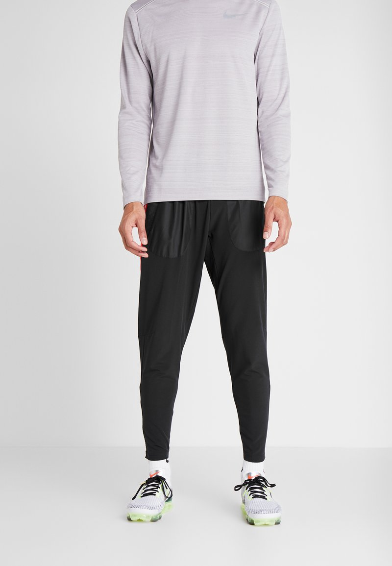 Nike Performance - WILD RUN PANT - Träningsbyxor - black/electric green/habanero red