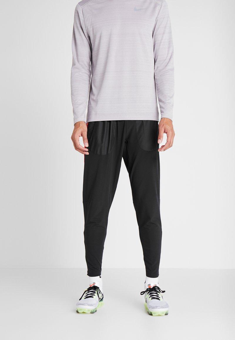 Nike Performance - WILD RUN PANT - Pantalones deportivos - black/electric green/habanero red