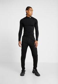 Nike Performance - PANT - Pantalones deportivos - black - 1