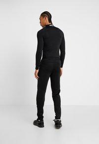 Nike Performance - PANT - Pantalones deportivos - black - 2