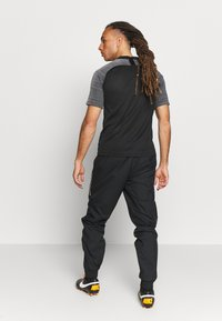 Nike Performance - FC PANT  - Trainingsbroek - black/black/white - 2