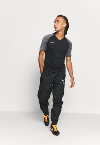Nike Performance - FC PANT  - Trainingsbroek - black/black/white - 1