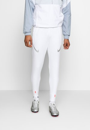 STRIKE PANT - Tracksuit bottoms - white/metallic silver