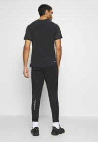 Nike Performance - ELITE - Tracksuit bottoms - black/summit white - 2