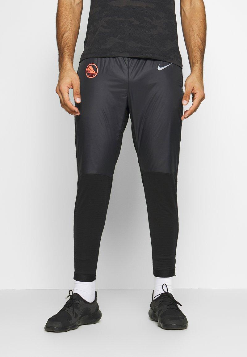 Nike Performance - ELITE - Tracksuit bottoms - black/summit white
