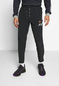 Nike Performance - PANT  - Pantalon de survêtement - black - 0