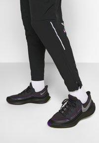 Nike Performance - PANT  - Pantalon de survêtement - black - 4