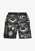 WILD RUN - Sports shorts - black