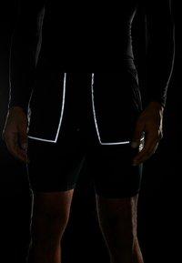 Nike Performance - M NK SHORT 7IN FUTURE FAST - Sports shorts - black/dark smoke grey/reflective silver - 7