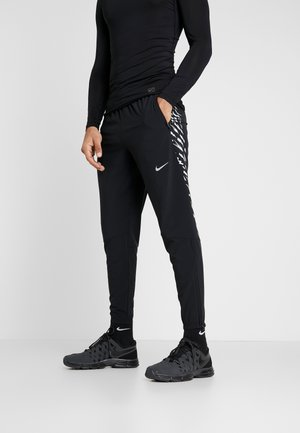 WOVEN PANT - Tracksuit bottoms - black/silver