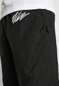 Nike Performance - PANT  - Verryttelyhousut - black/smoke grey/white - 4