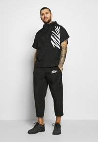 Nike Performance - PANT  - Verryttelyhousut - black/smoke grey/white - 1