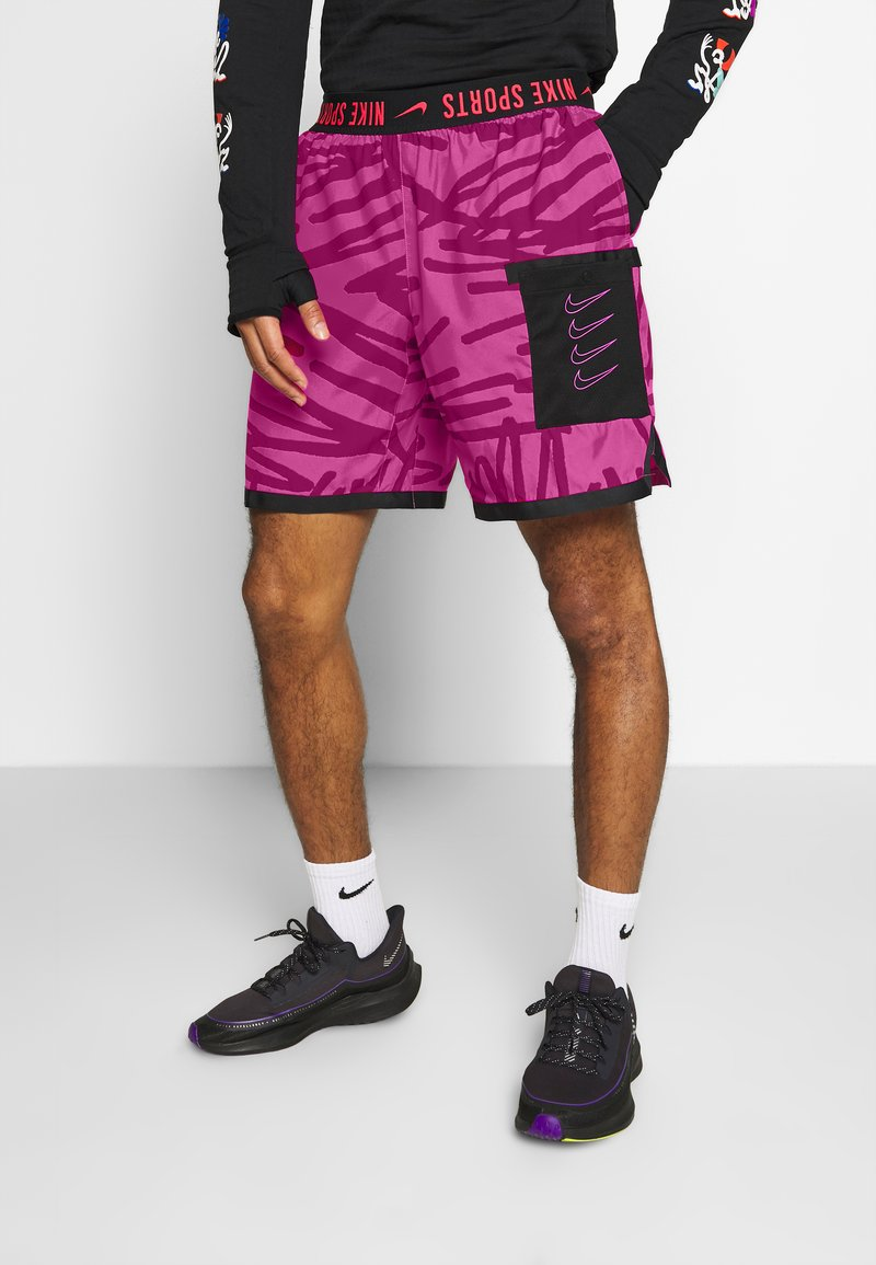 Nike Performance - SHORT  - Sports shorts - fire pink/noble red
