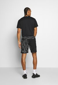 Nike Performance - SHORT  - Sports shorts - black/white - 2
