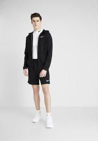Nike Performance - Pantalón corto de deporte - black/white - 1