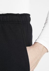 Nike Performance - Pantalón corto de deporte - black/white - 3