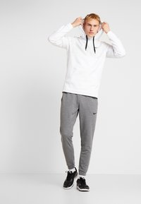 Nike Performance - Trainingsbroek - charcoal heathr/black - 1