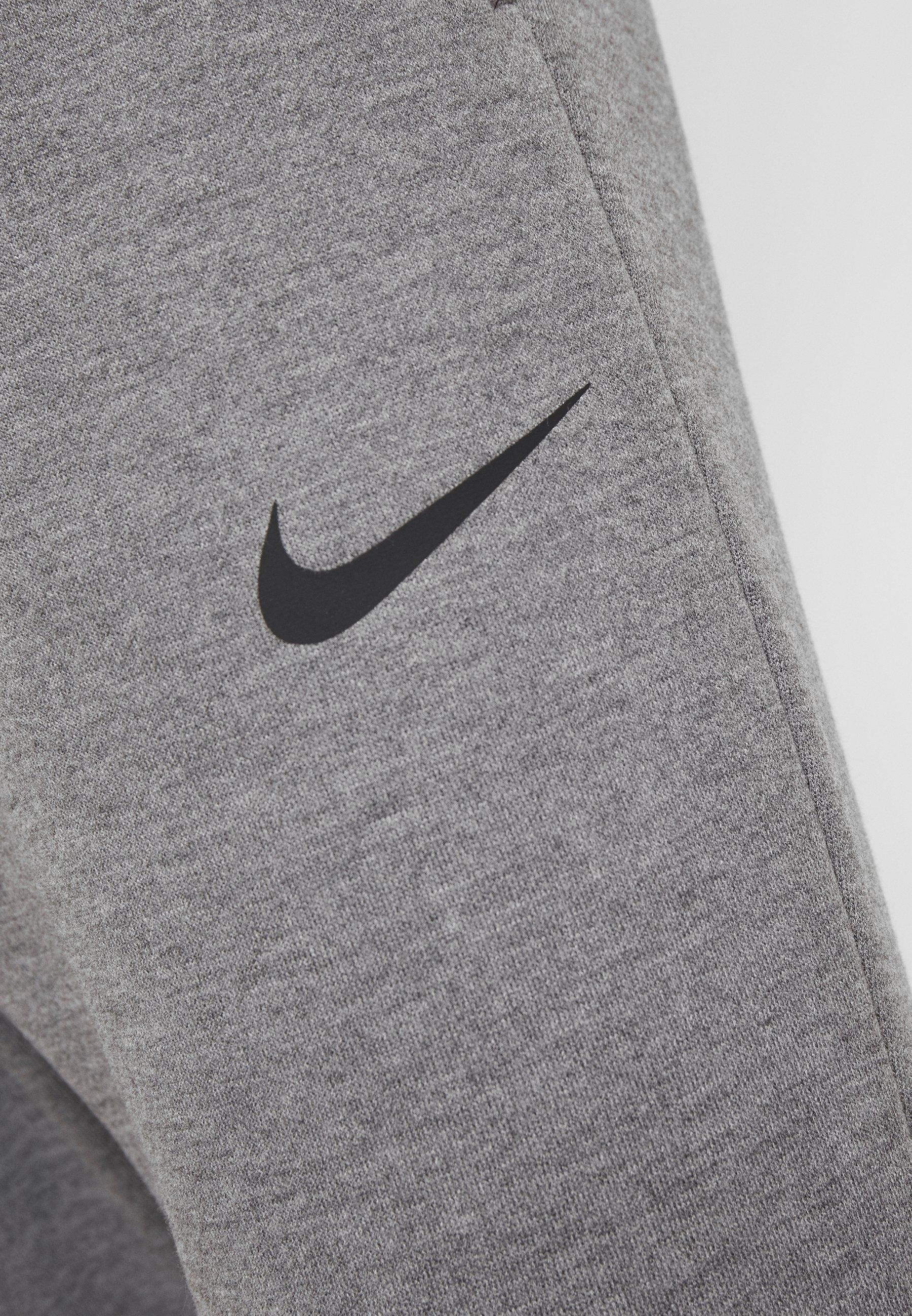 Nike Performance DRY PANT TAPER - Spodnie treningowe - charcoal heathr/black