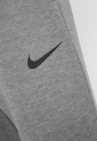 Nike Performance - Trainingsbroek - charcoal heathr/black - 5