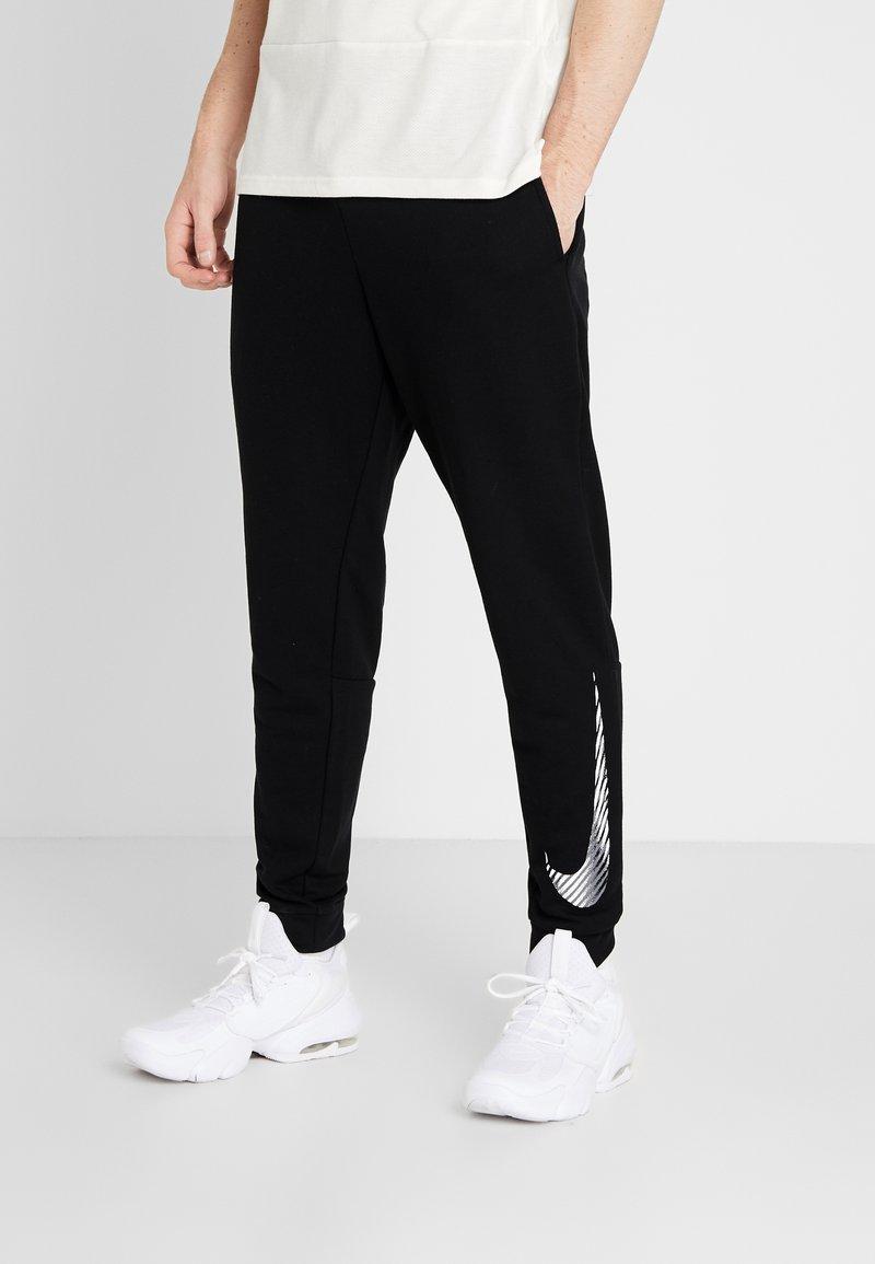 Nike Performance - MFLC GFX - Pantalones deportivos - black