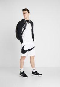 Nike Performance - DRY SHORT - Pantalón corto de deporte - white/black - 1