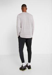 Nike Performance - ELITE PANT - Verryttelyhousut - black/silver - 2