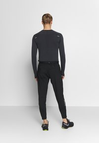 Nike Performance - ELITE PANT - Verryttelyhousut - black/reflective silver - 2
