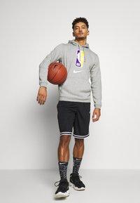 Nike Performance - DRY DNA SHORT - Krótkie spodenki sportowe - black/black/white - 1