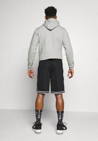 Nike Performance - DRY DNA SHORT - Krótkie spodenki sportowe - black/black/white - 2