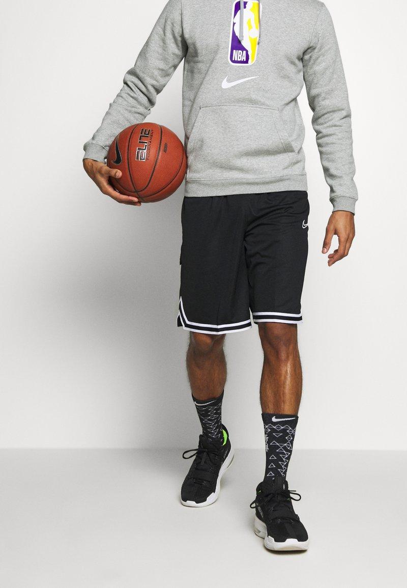 Nike Performance - DRY DNA SHORT - Krótkie spodenki sportowe - black/black/white