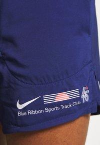 Nike Performance - STRIDE SHORT - Pantalón corto de deporte - blue void/white - 3