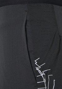 Nike Performance - FLEX STRIDE - Sports shorts - black/reflective silver - 2