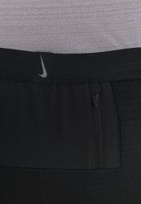 Nike Performance - PANT TRAIL - Verryttelyhousut - black/laser crimson - 6
