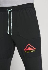 Nike Performance - PANT TRAIL - Verryttelyhousut - black/laser crimson - 3