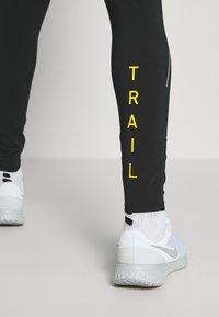 Nike Performance - PANT TRAIL - Verryttelyhousut - black/laser crimson - 4