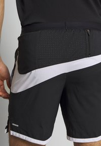 Nike Performance - Sports shorts - black/white/reflective silver - 4