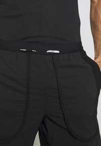 Nike Performance - Sports shorts - black/white/reflective silver - 3