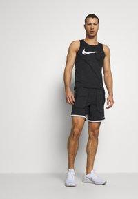 Nike Performance - Sports shorts - black/white/reflective silver - 1