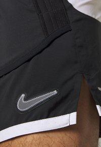 Nike Performance - Sports shorts - black/white/reflective silver - 6